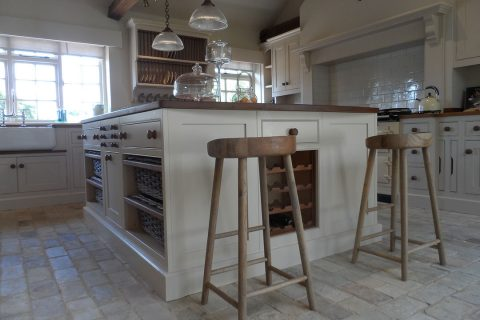 Bespoke country farmhouse kitchen island with in-built wine rack and handmade stools