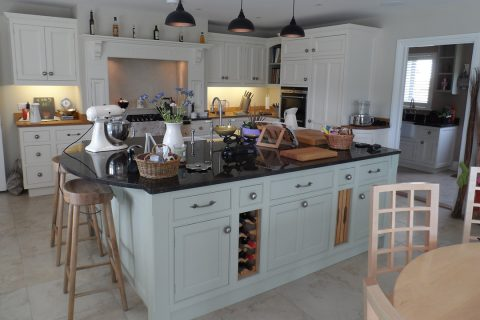 A Family Kitchen with Granite Island, Aga, Cabinets and Furniture